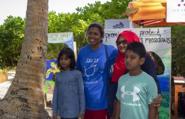September 1, 2018, L. Maabaidhoo: Chief Guest Zoona Naseem (L-2) pose with festival-goers at the Laamu Turtle Festival 2018. PHOTO: HAWWA AMAANY ABDULLA / THE EDITION