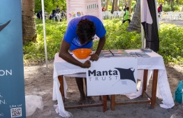 September 1, 2018, L. Maabaidhoo: Manta Trust stall at the Laamu Turtle Festival 2018. PHOTO: HAWWA AMAANY ABDULLA / THE EDITION