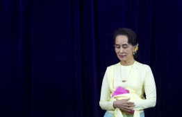 Myanmar State Counsellor Aung San Suu Kyi leaves after delivering address before students of Yangon University general assembly in Yangon on August 28, 2018. The address was Aung San Suu Kyi's first public appearance after Facebook banned Myanmar's army chief and other top military brass on August 27 after a UN investigation recommended they face prosecution for genocide for a crackdown on Rohingya Muslims. / AFP PHOTO / YE AUNG THU