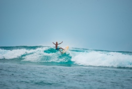 A surfer competes at the first ever Soneva Surf Pro held in B.Goidhoo. PHOTO/SONEVA FUSHI