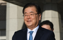 Chung Eui-yong, head of the presidential National Security Office, walks to board an aircraft as they leave for Pyongyang at a military airport in Seongnam, south of Seoul, on September 5, 2018.   A high-level South Korean delegation left for North Korea on September 5, to discuss arrangements for an inter-Korean summit there this month, as relations grow cooler between Washington and Pyongyang.  / AFP PHOTO / pool / Jung Yeon-je