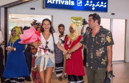 The one millionth tourist to arrive in Maldives in September 2018 receives a colourful welcome. PHOTO: MIHAARU