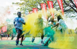 Participants are rewarded with a burst of colour powder at a kilometre-mark during the Ooredoo Color Run 2017 in Hulhumale. PHOTO/OOREDOO