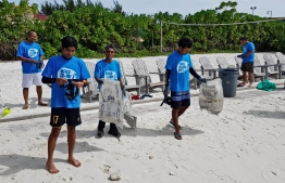 During a cleanup organised by Let's do it!Maldives. PHOTO/LET'S DO IT! MALDIVES