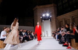 (FILES) In this file photo taken on September 10, 2017, models walk the runway for the Victoria Beckham SS18 show during New York Fashion Week in New York. London Fashion Week opens on September 14, 2018, with all eyes on Victoria Beckham, who debuts at the event on the 10th anniversary of her label's launch, and on Burberry's new star designer Riccardo Tisci. The ex-Spice Girl, celebrating a decade since her brand's 2008 unveiling in New York, has since defied the naysayers and won the respect of her peers.  / AFP PHOTO / EDUARDO MUNOZ ALVAREZ