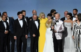 Ryan Murphy (R) and cast and crew accepts the Outstanding Limited Series award for 'The Assassination of Gianni Versace: American Crime Story' speak onstage during the 70th Emmy Awards at the Microsoft Theatre in Los Angeles, California on September 17, 2018. / AFP PHOTO / Robyn Beck