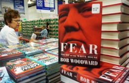 "(FILES) In this file photo taken on September 11, 2018 Veteran journalist Bob Woodward's latest book ""Fear: Trump in the White House"" is displayed for sale at a Costco store in Alhambra, California on September 11, 2018. Woodward's incendiary ""Fear: Trump in the White House"" has become the fastest selling book in Simon and Schuster's history, the publisher said on September 18, 2018, shifting 1.1 million copies in its first week. / AFP PHOTO / Frederic J. BROWN"