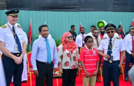 President Abdulla Yameen Abdul Gayoom and First Lady Fathmath Ibrahim and their youngest son with the pilots of Etihad's A380. PHOTO: PRESIDENT OFFICE