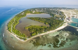 Aerial view of HDh.Kulhudhuffushi, depicting the island's mangrove lake prior to its reclamation for the island's new airport.