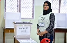 September 23, 2018: An election official stands beside a ballot box during the Presidential Elections 2018. PHOTO: NISHAN ALI/MIHAARU