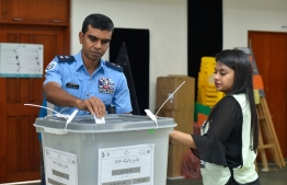 September 23, 2018: A police officer casts his ballot in the Presidential Elections 2018. PHOTO: AHMED NISHAATH/MIHAARU