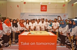 Dhiraagu's staff pose for a picture on the occasion of the company's 30th anniversary. PHOTO: DHIRAAGU