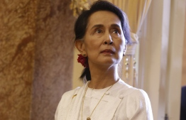 (FILES) In this file photo taken on September 12, 2018 Myanmar State Counsellor Aung San Suu Kyi arrives for a meeting with Vietnam's President Tran Dai Quang (not pictured) at the Presidential Palace at the sideline of the World Economic Forum on ASEAN in Hanoi. Canada's parliament voted unanimously on September 27, 2018 to effectively strip Myanmar leader Aung San Suu Kyi of her honorary Canadian citizenship over the Rohingya crisis. Ottawa had given the long-detained democracy advocate and Nobel laureate the rare honor in 2007.But her international reputation has become tarnished by her refusal to call out the atrocities by her nation's military against the Rohingya Muslims minority, which Ottawa last week declared a genocide.  / AFP PHOTO / POOL / KHAM