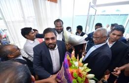 Jumhooree Party founder Qasim Ibrahim warmly welcomed upon his arrival in Maldives. PHOTO: NISHAN ALI / MIHAARU