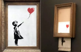 The Banksy artwork shredded itself during the auction. Photo: PA