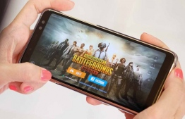 A person plays PUBG on their smart phone.