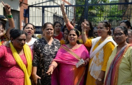 Indian activists shout slogans outside a police station as they demand justice for Bollywood actress Tanushree Dutta, who has alleged a sexual harrasment by actor Nana Patekar, in Mumbai on October 11, 2018. - The Indian actress whose public allegations of sexual harassment by a Bollywood star is sparking a string of similar #MeToo claims has filed a formal complaint, police told AFP October 7. Former Miss Universe contestant Tanushree Dutta first alleged in 2008 that multi-award-winning Nana Patekar behaved inappropriately towards her during the making of a romantic comedy the same year. (Photo by PUNIT PARANJPE / AFP)