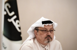(FILES) In this file photo taken on December 15, 2014, general manager of Alarab TV, Jamal Khashoggi, looks on during a press conference in the Bahraini capital Manama. - US President Donald Trump said October 11, 2018 he was not yet prepared to limit arms sales to Saudi Arabia over journalist Jamal Khashoggi's disappearance, but he faced mounting pressure from concerned American lawmakers. Saudi Arabia is one of the world's largest arms purchasers, with most of them coming from the United States.Khashoggi, a contributor to The Washington Post, vanished more than a week ago during a visit to the Saudi consulate in Istanbul. Turkish government sources say he was murdered there, a claim Riyadh denies. (Photo by MOHAMMED AL-SHAIKH / AFP)