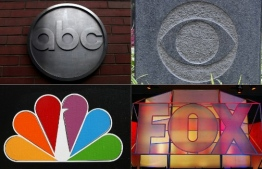 """(COMBO) This combination of file pictures created on October 16, 2018 shows (Clockwise from top L), the ABC logo outside of its headquarters February 24, 2010 in New York;  The CBS logo at the network's headquarters on August 6, 2018, in New York; The Fox Network logo is displayed on January 17, 2005, in Universal City, California; The NBC logo on the network's studios on October 20, 2008 in Burbank, California. - They once produced must-see television shows like """"Seinfeld,"""" """"ER"""" and """"Friends"""" but America's broadcast networks are facing a major crisis, as more and more viewers cut the cord in search of innovative content elsewhere. Some are even wondering if there is a future for scripted television on ABC, CBS, NBC and Fox, which was roundly snubbed in major categories at the Emmy Awards in September 2018. (Photos by various sources / AFP)"""