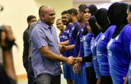 Picture depicting Volleyball Association of Maldives (VAM)'s President Mohamed Latheef shaking hands with the athletes. PHOTO: NISHAN ALI / MIHAARU