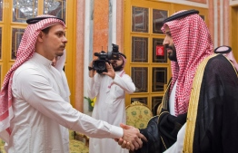"""A handout picture provided by the Saudi Press Agency (SPA) on October 23, 2018 shows Saudi Crown Prince Mohammed bin Salman meeting with family members of slain journalist Jamal Khashoggi in Riyadh. - The Saudi rulers met with Khashoggi's son Salah and brother Sahel at the royal palace, state-run news agency SPA reported. The report said King Salman and Prince Mohammed offered their condolences to the family of the Saudi journalist. (Photo by Handout / SPA / AFP) / === RESTRICTED TO EDITORIAL USE - MANDATORY CREDIT """"AFP PHOTO / HO / SPA"""" - NO MARKETING NO ADVERTISING CAMPAIGNS - DISTRIBUTED AS A SERVICE TO CLIENTS ==="""