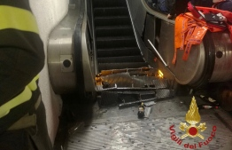 """This handout picture taken and released by the Vigili del Fuoco, the Italian fire and rescue service, on October 23, 2018 shows the wreckage of an escalator after it jammed at the underground metro station """"Repubblica"""" in Rome, injuring at least fifteen people. - Some fifteen people were injured, five seriously, including Russian supporters of CSKA Moscow on their way to attend the Champions League football match AS Rome vs CSKA Moscow, after a portion of an escalator got jammed at rush hour in the central metro station """"Repubblica"""" of the Italian capital. (Photo by Handout / Vigili del Fuoco / AFP) / RESTRICTED TO EDITORIAL USE - MANDATORY CREDIT """"AFP PHOTO / HO / VIGILI DEL FUOCO"""" - NO MARKETING NO ADVERTISING CAMPAIGNS - DISTRIBUTED AS A SERVICE TO CLIENTS"""