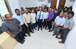 President Elect Ibrahim Mohamed Solih posing for a picture with Mihaaru media staff. PHOTO: HUSSAIN WAHEED / MIHAARU