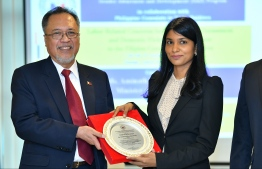 Vicente Vivencio T. Bandillo, the non-resident Phillipine Ambassador to Maldives (L), presents a plaque to Aminath Zenysha Shaheed Zaki, the Minister of Gender and Family at the Gender Awareness and Development Program (GAD) hosted by the Philippine Embassy in Bangladesh. PHOTO: HUSSAIN WAHEED/MIHAARU
