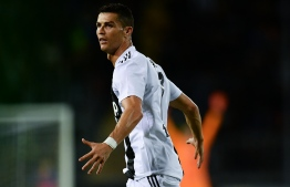 FILE PHOTO: Juventus' Portuguese forward Cristiano Ronaldo celebrates after scoring a goal during the Italian Serie A football match between Empoli and Juventus on October 27, 2018 at the Carlo Castellani Stadium in Empoli. (Photo by MARCO BERTORELLO / AFP)