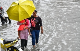 Male City: People wade through flooded streets after heavy monsoon showers. PHOTO: NISHAN ALI/MIHAARU