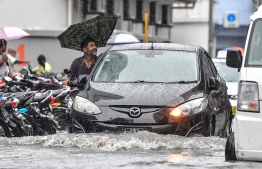 Male City: Cars drive along flooded streets after heavy monsoon showers. PHOTO: NISHAN ALI/MIHAARU