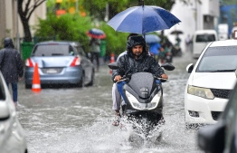 Male City: Motorcyclists drive along flooded streets after heavy monsoon showers. PHOTO: NISHAN ALI/MIHAARU