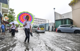 Male City: People wade through flooded streets after heavy monsoon showers. PHOTO/MIHAARU
