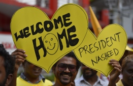 November 1, 2018, Male City: Supporters hold up placards to welcome former President Mohamed Nasheed upon his return to Maldives after 3 years. PHOTO: AHMED NISHAATHI/MIHAARU