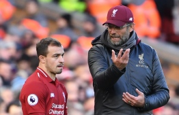 Liverpool's German manager Jurgen Klopp (R) talks with Liverpool's Swiss midfielder Xherdan Shaqiri (L) on the touchline during the English Premier League football match between Liverpool and Cardiff City at Anfield in Liverpool, north west England on October 27, 2018. (Photo by Paul ELLIS / AFP) / RESTRICTED TO EDITORIAL USE. No use with unauthorized audio, video, data, fixture lists, club/league logos or 'live' services. Online in-match use limited to 120 images. An additional 40 images may be used in extra time. No video emulation. Social media in-match use limited to 120 images. An additional 40 images may be used in extra time. No use in betting publications, games or single club/league/player publications. /