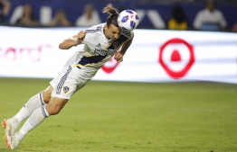 (FILES) In this file photo taken on July 29, 2018  Zlatan Ibrahimovic #9 of the Los Angeles Galaxy heads the ball into the goal at StubHub Center in Carson, California. - Sweden's Zlatan Ibrahimovic, England's Wayne Rooney and Venezuelan striker Josef Martinez were among five finalists named October 31, 2018 for Major League Soccer's 2018 Most Valuable Player Award. Hours before the North American league began its playoff championship run, the league announced finalists for its season awards, topped by the MVP race, which also includes Mexico's Carlos Vela and Paraguayan midfielder Miguel Almiron. (Photo by Katherine LOTZE / GETTY IMAGES NORTH AMERICA / AFP)
