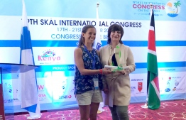 Biologist Jenni Choma accepts the Marine Conservation award on behalf of Six Senses Laamu at the 79th Skål World Congress in Mombasa, Kenya. PHOTO/SIX SENSES LAAMU