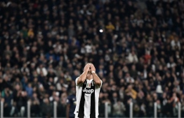 Juventus' Portuguese forward Cristiano Ronaldo reacts at the end of the UEFA Champions League group H football match Juventus vs Manchester United at the Allianz stadium in Turin on November 7, 2018. (Photo by Marco BERTORELLO / AFP)