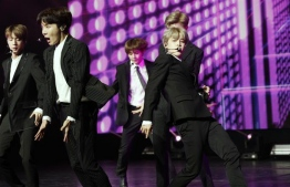 South Korean pop group BTS performs during a Korean cultural event in Paris [Yoan Valat/AP]