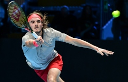 Greece's Stefanos Tsitsipas returns to Australia's Alex De Minaur during the men's final of the Next Generation ATP Finals in Milan on November 10, 2018. (Photo by Miguel MEDINA / AFP)