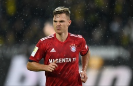 Bayern Munich's midfielder Joshua Kimmich reacts after the German first division Bundesliga football match BVB Borussia Dortmund v FC Bayern Munich in Dortmund, western Germany, on November 10, 2018. (Photo by Christof STACHE / AFP) / RESTRICTIONS: DFL REGULATIONS PROHIBIT ANY USE OF PHOTOGRAPHS AS IMAGE SEQUENCES AND/OR QUASI-VIDEO
