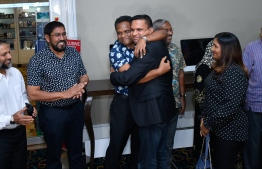 Former Minister of Defence and Security embracing his brother during his arrival in Velana International Airport (VIA). PHOTO: AHMED NISHAATH/MIHAARU