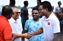 November 18, 2018, Male City: Former President Maumoon Abdul Gayoom shakes hands with Vice President Faisal Naseem during the 'Dhulhaheyo Hashiheyo Eid' sports festival. PHOTO: AHMED NISHAATH/MIHAARU