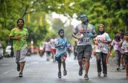 Participants running in Ooredoo Color Run 2018. PHOTO: NISHAN ALI/ MIHAARU