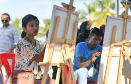 Artists during the live painting session at the 5-year anniversary show of 'Fannuge Dharin'. PHOTO: AHMED NISHAATH/MIHAARU