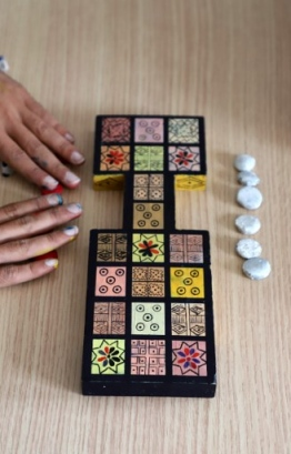 Iraqi artist Hoshmand Mofaq sits over an ancient board game, known as the Royal Game of Ur, in the northern Iraqi city of Raniey on October 22, 2018. - Originating nearly 5,000 years ago in what would become Iraq, the Royal Game of Ur mysteriously died out -- until Muwafaq resurrected it by making his own decorated wooden board. (Photo by SHWAN MOHAMMED / AFP)