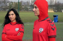 Afghani national soccer team player Shabnam Mabarz, right, stands next to Khalida Popal. PHOTO: DAWN