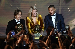 (FromL) 2018  Ballon d'Or awarded for best player of the year, Men's Ballon d'Or Real Madrid's Croatian midfielder Luka Modric, Women's Ballon d'Or Olympique Lyonnais' Norwegian forward Ada Hegerberg and Under-21 Ballon d'Or (Kopa trophy) Paris Saint-Germain's French forward Kylian Mbappe pose at the end of the 2018  Ballon d'Or award ceremony at the Grand Palais in Paris on December 3, 2018. (Photo by FRANCK FIFE / AFP)