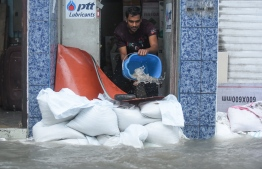 A man bailing out floodwater during the flooding of Male' on November 5. PHOTO: AHMED NISHAATH/MIHAARU