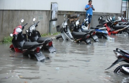 Motorcycles flooded halfway on a street in Male' on November 5. PHOTO: AHMED NISHAATH/MIHAARU